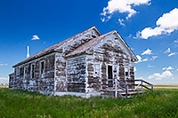 An old abandoned one room schoolhouse sits on the side of the highway near Hemingford, Nebraska. - Nebraska Landscape Photograph