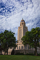 The Nebraska state capitol building in Lincoln was designed by famed architect Bertram Grosvenor Goodhue and was completed in 1932.  Incorporated in its design are several designs by Lee Lawrie and is crowned by the statue,