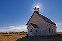 The 1887 Immaculate Conception Catholic Church and Cemetery are all that remain of the Montrose, Nebraska on the wind-swept prairie of the Oglala National Grassland. - Nebraska Photograph