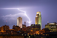 While setting up to capture the 9/11 tribute in downtown Omaha I instead witnessed a spectacular fall storm.  I managed to capture this lightning between the Woodmen Tower and the First National Bank Tower. - Nebraska Photograph