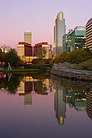 Downtown Omaha, Nebraska on the Gene Leahy Mall in the Early Morning just before sunrise.  The two larger skyscrapers, the Woodman Tower and the First National Bank building dominate the skyline. - Nebraska Photograph