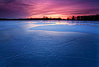 The former oxbow of the Missouri River, DeSoto Bend is completely frozen on a frigid January evening. - Nebraska Photograph