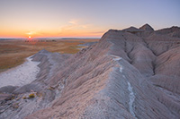 The sun rises over the western Nebraska plains from atop a ridge in Toadstool Geologic Park. - Nebraska Photograph