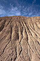 Clouds float lazily over the eroded hills at Toadstool Geologic Park. - Nebraska Photograph