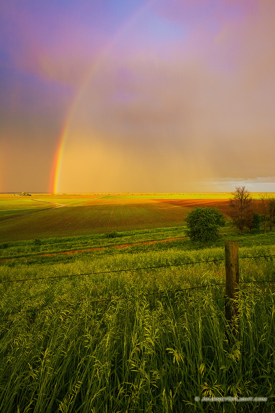 After a rain storm a stunning rainbow touches the ground on the Missouri Valley plains. - Nebraska Picture