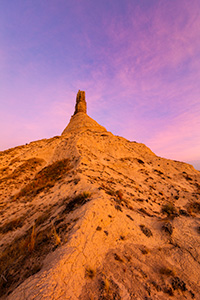 A scenic vertical landscape Nebraska photograph of a sunset and Chimney Rock in western Nebraska. - Nebraska Photograph