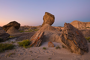 The badlands landscape at Toadstool Geologic Park is quiet in the twilight just before sunrise on a summer morning. - Nebraska Photograph