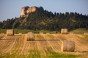A Nebraska photograph of Hay Bales in the morning under Lovers Leap at Fort Robinson State Park. - Nebraska Photograph