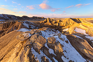 Scenic landscape photograph of Toadstool Geologic Park in western Nebraska after snow. - Nebraska Photograph