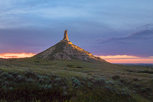 A scenic landscape Nebraska photograph of Chimney Rock illuminated at night. - Nebraska Photograph