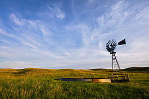 Late afternoon sun illuminates an abandoned windmill deep in the Sandhills of Nebraska. - Nebraska Sandhills Photograph