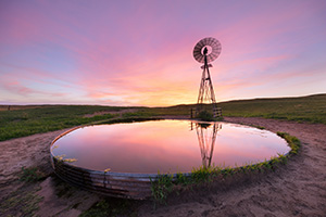 A photograph of a windmill in the Nebraska Sandhills during a summer sunset. - Nebraska Sandhills Photograph