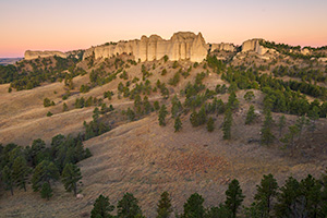 A scenic landscape photograph of the sunrise on the Red Cloud Buttes at Ft. Robinson in Northwestern Nebraska. - Nebraska Landscape Photograph