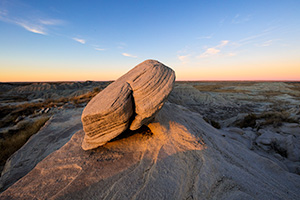 Scenic landscape photograph of Toadstool Geologic Park illuminated by last light in western Nebraska. - Nebraska Photograph