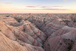 Dusk comes to Badlands National Park and the landscape is bathed in pastel hues. - South Dakota Photograph