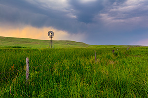 A Nebraska landscape scenic photograph of a windmill during a storm in the Sandhills of Nebraska. - Nebraska Photograph