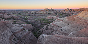 A panoramic scenic photograph of the sunrise over the Badlands National Park, South Dakota. - South Dakota Photograph