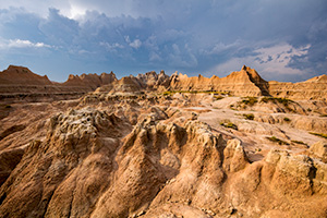 A photograph of an afternoon thunderstorm moving through the Badlands National Park, South Dakota. - South Dakota Photograph