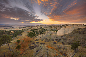 A scenic landscape photograph of a beautiful sunset over Fort Robinson State Park in Northwestern Nebraska. - Nebraska Landscape Photograph