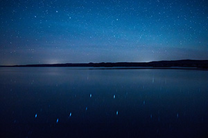 On a clear night at Niobrara State Park the stars shone brightly above the Missouri River.  In the reflection of the river the Big Dipper can be clearly seen. - Nebraska Landscape Photograph