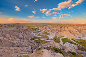 A scenic landscape photograph of sunset over the badlands Toadstool Geologic Park in western Nebraska. - Nebraska Photograph
