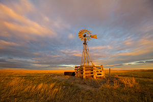 Scenic landscape photograph of a windmill at sunset at Oglala National Grasslands. - Nebraska Photograph