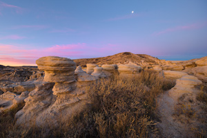 Scenic landscape photograph of a moonset over Toadstool Geologic Park in western Nebraska. - Nebraska Photograph