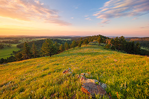A beautiful sunrise illuminates the hills of Wind Cave National Park in South Dakota. - South Dakota Photograph