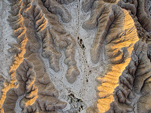 An abstract drone landscape photograph of the badlands Toadstool Geologic Park in western Nebraska. - Nebraska Photograph