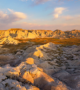 A vertical scenic photograph of the badlands Toadstool Geologic Park in western Nebraska. - Nebraska Photograph