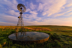 A beautiful sunrise and windmill in the sandhills of western Nebraska. - Nebraska Nature Photograph