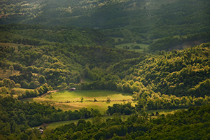 Rays of light illuminate the hills of the Ozarks in Northern Arkansas. - Arkansas Photograph