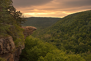 Rays of light illuminate the Ozarks at Whitaker Point while Hawksbill Crag juts out from the side of the hill.  Hills blanketed in verdant trees can be seen for miles around.</a><p>This image was featured in the 'Traveling the Journey of Light' Photoblog on May 13, 2010.  <a href='http://blog.journeyoflight.com/2010/05/13/a-story-from-the-field-illumination-at-whitaker-point-hawksbill-crag/' target=_blank>Click Here To See the Post</a> - Arkansas Photograph