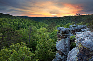 The last light of evening illuminates the clouds on the Kings Bluff trail in the Ozarks in Arkansas. - Arkansas Photograph