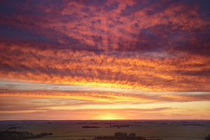 A beautiful sunrise crests over the distant farmland from the scenic overlook at Ponca State Park in Dixon County. - Nebraska Photograph