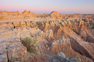 Warm sunlight hits the Badlands of South Dakota in Badlands National Park. - South Dakota Photograph