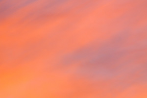 The setting sun illuminates these clouds with warm, inviting colors. - Nebraska Photograph