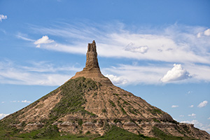 Clouds float above Chimney Rock, once a beacon to pioneers headed to the west for a better life. - Nebraska Photograph