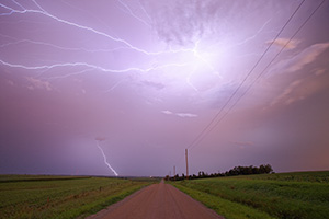 An intense lightning storm in rural eastern Nebraska lights up the sky with bolts extending in all directions. - Nebraska Photograph