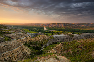 Sunlight streams across the Little Missouri valley in the North Unit of Theodore Roosevelt National Park, North Dakota. - North Dakota Landscape Photograph