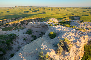 From high on Courthouse Rock a great expanse of the Nebraska Plains to the west are illuminated by the warmth of the rising sun. - Nebraska Photograph
