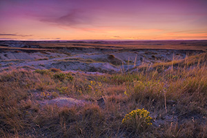 20 minutes past sunset, the very last light of the setting sun gives the prairie off of the Hudson-Meng Trail of the Oglala National Grassland an ethereal glow. - Nebraska Photograph