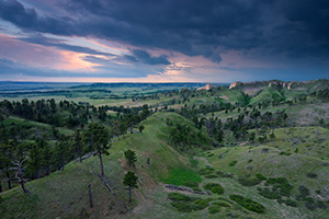 Clouds form in the evening over Ft. Robinson State Park in northwestern Nebraska.  Originally, a U.S. Army fort it has a checkered history in regards to the conflicts with Native Americans in the late 1800s. - Nebraska Landscape Photograph