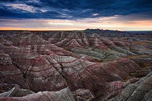 Early morning rays illuminate the Badlands in Badlands National Park, South Dakota.  Originally designated a National Monument, Badlands National Park was redesignated a National Park on November 10, 1978. - South Dakota Photograph
