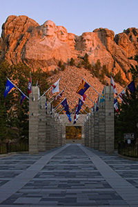Mt. Rushmore National Monument at sunrise with the Avenue of Flags in the Black Hills of South Dakota. - South Dakota Photograph