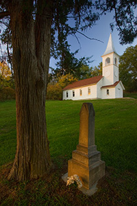 The Ingemann Danish Church and Cemetery west of Moorhead in the Loess Hills of Iowa was founded by early immigrants in 1884. This unique country church offers a scenic respite for travelers. - Iowa Photograph