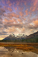 The first light illuminates the clouds above mountains on the Kootenay plains in Alberta, Canada. - Canada Photograph