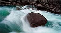 A lone rock holds against the rush of the water at Maligne Canyon in Banff National Park, Alberta, Canada. - Canada Photograph