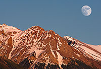The moon rises over the peaks on the Kootenay Plains in Western Alberta. - Canada Photograph