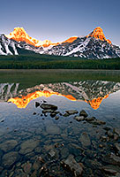 As the first light hits Mt. Cephron as mist rises from Upper Waterfowl Lake. - Canada Photograph